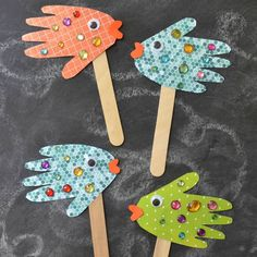 These beautiful Handprint Fish Puppets are super easy, really inexpensive and of course, fun for ALL ages! #artsandcraftsideas,