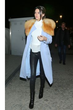 Kendall Jenner knows the importance of strong outerwear—she styles a high-contrast look of J Brand leather pants, and a white A.L.C. top with a gorgeous periwinkle coat.    - HarpersBAZAAR.com