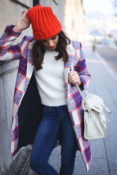 Shop this look on Lookastic:  http://lookastic.com/women/looks/beanie-and-crew-neck-sweater-and-skinny-jeans-and-overcoat-and-satchel-bag/958  — Red Beanie  — White Crew-neck Sweater  — Navy Skinny Jeans  — White Plaid Coat  — White Leather Satchel Bag