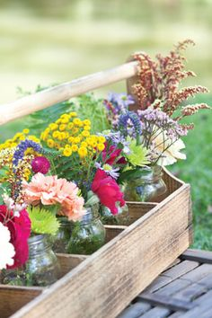 Picnic by the Lake | Arrange bright wildflowers in mason jars, and place them in a portable caddy for a festive centerpiece.