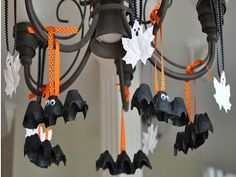 DIY Halloween decorations Hanging Bats and Ghosts Kids can help turn egg cartons into bat decorations; just cut, paint, and add googly eyes. Make cute, cheap Halloween ghosts by painting leaves white, then drawing a spooky face with a marker. Read more: http://www.rd.com/slideshows/cheap-halloween-decorations/#ixzz2dfxOtiZr
