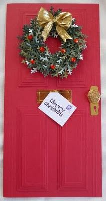 by Helen: Door Card with Christmas Wreath.The door was made by making 4 panels, each with 3 layers glued on top of each other, slightly smaller than the one below.