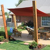 Sunbrella Shade Sails... kind of what i want to do in my yard for a seating area..