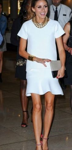 olivia palermo. white fluted skirt, cuff, ankle strap heels.