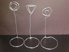 Recycle wire coat hangers into note or photo holders.  (hmmm...I have some colored wire hangers)