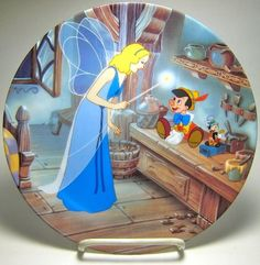 """When the Blue Fairy appears, something miraculous always happens! PINOCCHIO AND JIMINY CRICKET WITH THE BLUE FAIRY """"TREASURE MOMENTS"""" DECORATIVE PLATE (from Walt Disney's """"Pinocchio"""")"""