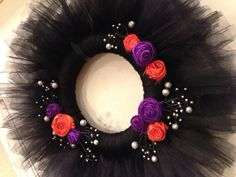 Spooky Halloween Wreath of Black Tulle and Orange and Purple Rolled Silk Flowers on Etsy, $32.00