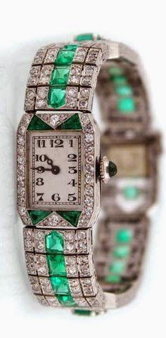 http://rubies.work/0241-ruby-rings/ Art Deco ~ Lady's platinum,diamond and emerald bracelet watch, ca. 1930  ~