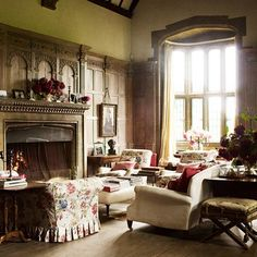 Traditional Living Area with Chintz Sofa in Living Room Ideas on HOUSE - design, food and travel by House & Garden. Wood panelling and matching wooden fireplace in the sitting area in the library