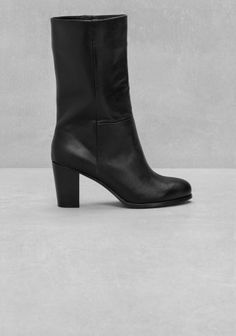 Clean-cut and classic, these leather boots feature a smooth surface with a wide shaft and a comfy mid-heel.