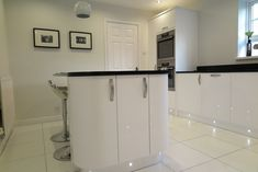 Signature Porter White Gloss and Black Quartz Worktops - Our Designs Home, Kitchen Cabinets, Cabinet, Gloss Cabinets, White Gloss Cabinets, Kitchen Appliances, White, Kitchen Design