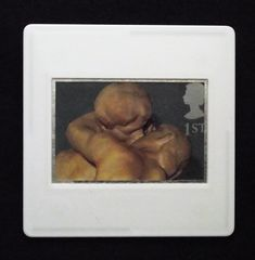 This close up of one of Auguste Rodin's most famous sculptures is printed as one of the set of ten Royal Mail postage stamps called 'Greetings Clown' issued in 1995. The unused stamp is of 'The Kiss ,' carved from marble in 1882. This sensual image of a couple embracing is encased in a vintage slide mount, with glass, making this a unique piece of jewellery.
