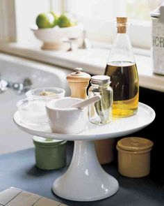 Clear up the clutter and make the most of your countertops by using a cake stand to hold olive oil, salt, pepper, and other frequently used seasonings. The stand makes it easy to find and use these ingredients while you cook, and gives you space to arrange other herbs and spices around the base of the pedestal. Get this How-To