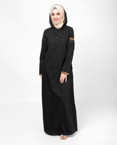 Feminine and stylist, this black color jilbab abaya features attached hood with button front opening adds a quality finish to this flattering jilbab Islamic Fashion, Muslim Fashion, Modest Fashion, Fashion Outfits, Hijab Dress, Hijab Outfit, Denim Abaya, Abaya Designs, Shirt Skirt