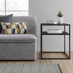 Bring clean lines and modern style into your space with the Metal End Table from Project 62™. This industrial-style square end table brings just the right amount of urban vibes. Top with a table lamp and use the second shelf to store books, records, remotes or coasters to keep your space clutter-free.<br><br>1962 was a big year. Modernist design hit its peak and moved into homes across the country. And in Minnesota, Target was born - with the revolutionary idea to celebra...