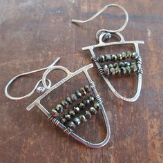 Daily bling! Boho in style, these dangling earrings are made of sterling silver with sparkling faceted coated Spinel rondelles. Constructed, textured and stamped and wire wrapped by me. Approxmately 1 1/4 inches in length, not including ear wires. 100% hand made.