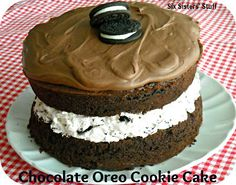 Chocolate Oreo Cookie Cake . . . chocolate cake, Oreo cheesecake middle . . . this cake is incredible! (And it's easy to make!) SixSistersStuff.com #cake #Oreo
