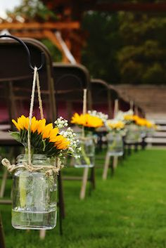 Shepherd's hooks ($1) and mason jars plus some twine and flowers... you've got yourself beautiful ceremony decorations!!