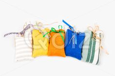 Qdiz Stock Photos   Decorative textile sachet pouches,  #background #bag #bow #burlap #cloth #container #craft #decoration #decorative #fabric #filled #gift #handmade #homemade #isolated #material #package #packaging #packet #poke #pouch #present #ribbon #sac #sachet #sack #small #sparse #textile #white
