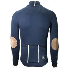 The Cafe du Cycliste Yolande Jersey is a merino wool based long sleeved road riding jersey, finished with careful detailing and ride-specific features.Made from a technical merino fabric blend that offers natural fibre benefits alongside enhanced garment longevity, the Yolande sports 3 deep rear pockets, a zipped key pocket, chest iPod pocket