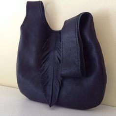 Soft leather Japanese knot bag with feather detail. The perfect party bag