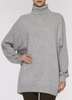 Just bought this Vince sweater to wear with my new leather pants. Uh-huh...Yes I di-id. I bought leather pants for the first time at 57!!! So great with this sweater and my black Kohl Hahn boots from last year.