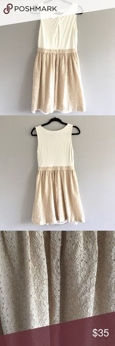 VINCE CAMUTO Fit and Flare Dress Vince Camuto fit and Flare dress. White with a beautiful cream Lace Flare. Flattering twist on the chest. In excellent ore owned condition. 96% rayon 4% spandex. Vince Camuto Dresses Midi