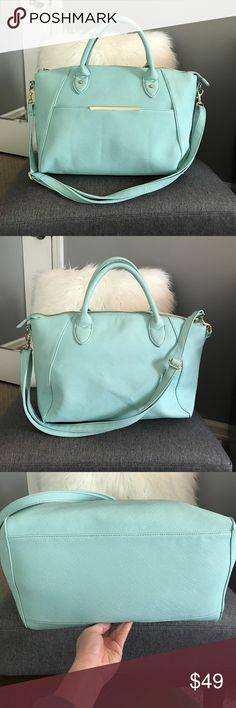 """Mint Faux Leather Large Satchel/Crossbody Like new gently used faux mint leather satchel with removable and adjustable straps.  Functioning front pocket, top zip, interior zip pocket and media pockets.  Cute black and white stripe lining.  Not sure of brand.  NOT ZARA.  Extremely Small mark on back handle.  Back is slightly wrinkled on back because I had it folded flat in my closet, but it comes out with use.  Measures 16"""" at widest and 11 tall.  Could be a chic baby bag! Zara Bags Baby Bags"""