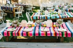 Really like the idea of using brightly colored Mexican blankets as a tablecloth for our patio table.  These might be neat as a stair runner too...