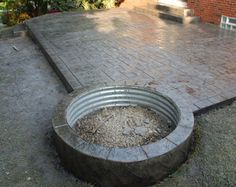 stamped concrete gray black Stamped Concrete Patio with Fire Pit