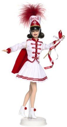 """Barbie Coca-Cola Collector Doll by Mattel. $45.94. Fifth in the COCA-COLA Barbie Series. Bubbly spirit and sweet times are the heart of great memories. Remember the sheer joy of family and friends gathered on Main Street to watch a parade.. Coca Cola BARBIE Doll Collector Edition """"Majorette"""""""