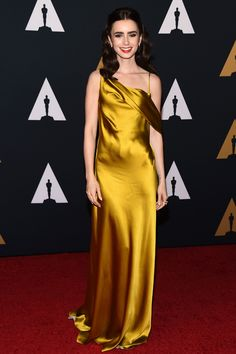 We can't get over this gorgeous gold gown on Lily Collins!