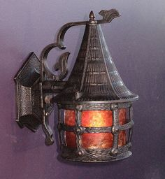 """Storybook style vintage porch light with a """"Witches Hat"""" top. Perfect size antique lamp to welcome someone up the winding path to the cottage door. Nicely refinished to match an original oil rubbed bronze color finish. Refitted with a new mica shade. Beautiful cottage"""