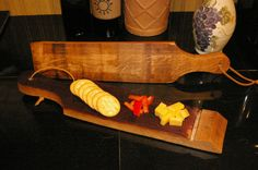 A cheese or snack board made from a wine barrel stave. No, it's not a paddle, although it may turn into one if people keep asking me! ;-) I use food-grade cutting board oil on it and really like how the oil brings out the texture on the outside of the barrel stave.