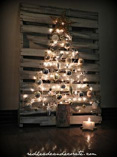 Turn a wood pallet into a Christmas tree (#atiasmall - cute idea! Just make sure they're bug-free first.)
