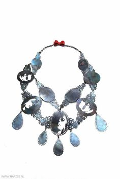 Vera Siemund - necklace, 2012, steel, enamelled copper sawn, handmade chain - 320 x 240 x 10 mm - sawn portraits in historicised shapes of jewellery, hanging drops and red enamelled bow