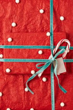 Red pom pom wrapping paper