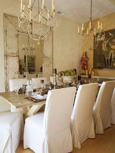 the mirror, use of 2 chandis, the rustic table and the covered chairs