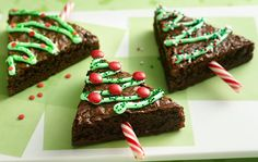 Christmas Tree Brownies | Cut in tree shape, add candy cane as tree stump & then deco with M n M's & frosting. DIY holiday treat & or dessert.