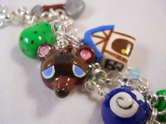 wowi kno im weird but i would legit wear this animal crossing charm bracelet.