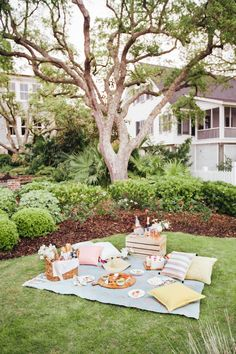 How to Picnic like an Event Planner as featured on Camille Styles | calder clark© | @ccolcolo | @blossomsevents | @crucharleston | @camillestyles |  A dear friend got engaged and we wanted to toast to her happiness. Inspired to keep it simple, a giant kantha throw, beautiful blooms, light noshes and ice cold champagne made for the perfect girls gathering.