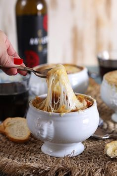 This rich broth-based Classic French Onion Soup recipe is topped with a cheesy crust that you will guard with your spoon…or knife. No sharing allowed. Hearty and comforting, this easy onion soup makes a regular appearance on our table. Turkey Broth, Turkey Soup, Classic French Onion Soup, Onion Soup Recipes, Baked Onion Soup Recipe, Winter Soups, Soups And Stews, Cooking Recipes, Favorite Recipes
