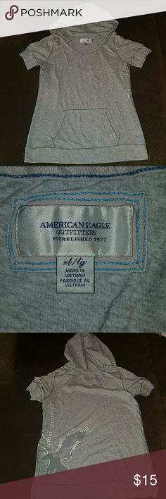 American Eagle hood t-shirt Light grey shirt with hood and front pockets. American Eagle XL. Gently worn - no holes or stains. American Eagle Outfitters Tops Tees - Short Sleeve
