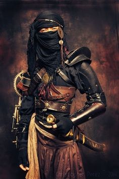 I definitely see the warriors of Sumar wearing something like this, though without the pistons and gears on the right arm. Chronicles of Chloe. Www.DTNelsonFantasyAuthor.com #fantasy #book #writing #inspiration #characters