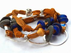 """Leather wrap bracelets seem to be """"the thing"""" nowadays. I love making them and, in my opinion, the chunkier the better. Throw them on your wrist with a silver chain bracelet, or as a single strand around your neck. Either way, it'll add some bling to your day!"""