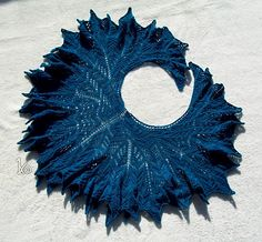 This is not a detailed pattern, but rather instructions for achieving a crescent shaped shawl with a ruffled edge. The example shawl was deliberately made very plain to show the structure of the shawl and the general purpose of these instructions is to function as a stepping stone for knitters who want to design their own ruffled crescent shawl. Because of this there are no specific instructions on yarn or needles, though the pattern does include information of the yarns used for the two…