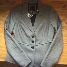 The limited charcoal blazer. The limited charcoal blazer, size small, new with tags's, three buttons in front, no pockets, Size small. I have the matching slacks in size 2. The Limited Jackets & Coats Blazers