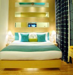 The splendid well furnished executive room. The interiors are well lit with contrasting colors of room decor.  http://www.jivitesh.com/blog/a-snug-little-retreat-in-new-delhi