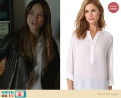 Cat's white half placket blouse and leather jacket on Beauty and the Beast. Outfit Details: http://wornontv.net/22806 #BeautyandtheBeast