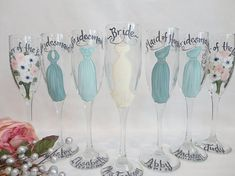 WHAT A CUTE KEEPSAKE FOR THE BRIDAL PARTY TO REMEMBER YOUR SPECIAL DAY!! These unique hand painted bridal party wine glasses will be PAINTED TO YOUR EXACT DRESSES that you will be wearing in YOUR wedding! They make the perfect thank you gift to everyone that took part in your wedding, or